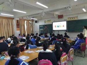 Kids learning STEM in classroom with RoboThink presentation