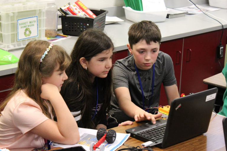 Group of Kids Discuss Coding
